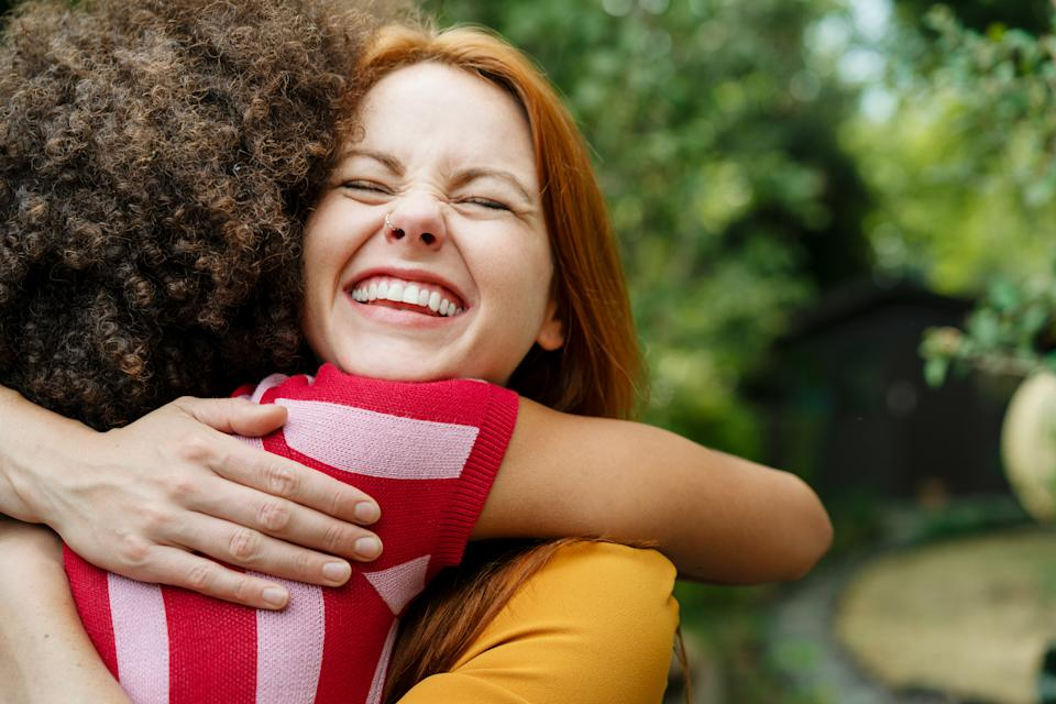 Turns out we've really missed being able to hug our friends. (Posed by models, Getty Images)