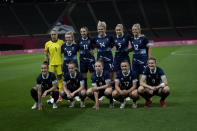 Britain's players pose for a team photo prior during a women's soccer match against Chile at the 2020 Summer Olympics, Wednesday, July 21, 2021, in Sapporo, Japan. (AP Photo/Silvia Izquierdo)