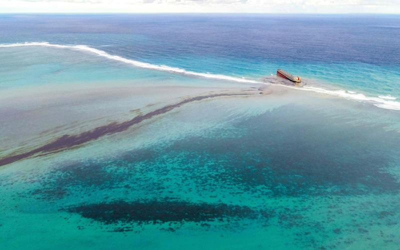 A large patch of leaks out of the MV Wakashio that ran aground near Blue Bay Marine Park off the coast of south-east Mauritius. - AFP