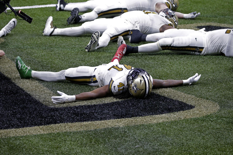 New Orleans Saints running back Alvin Kamara (41) celebrates his sixth touchdown of the game, tying the NFL record for most rushing touchdowns in a game, in the second half of an NFL football game against the Minnesota Vikings in New Orleans, Friday, Dec. 25, 2020. (AP Photo/Butch Dill)