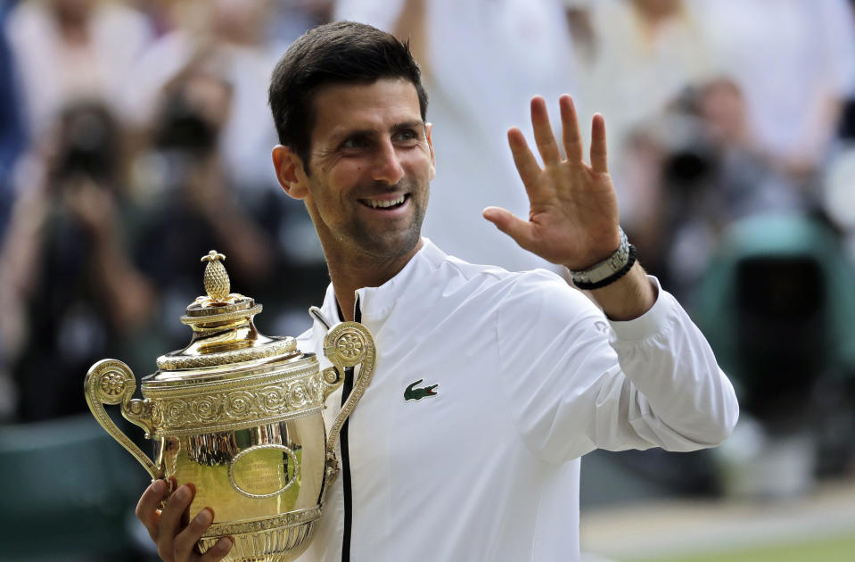 Serbia's Novak Djokovic holds his trophy after defeating Switzerland's Roger Federer in the men's singles final match of the Wimbledon Tennis Championships in London, Sunday, July 14, 2019. (AP Photo/Ben Curtis)