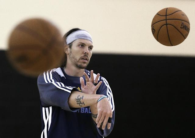 Memphis Grizzlies' Mike Miller passes a ball during NBA basketball training camp on Tuesday, Oct. 1, 2013, in Nashville, Tenn. (AP Photo/Mark Humphrey)