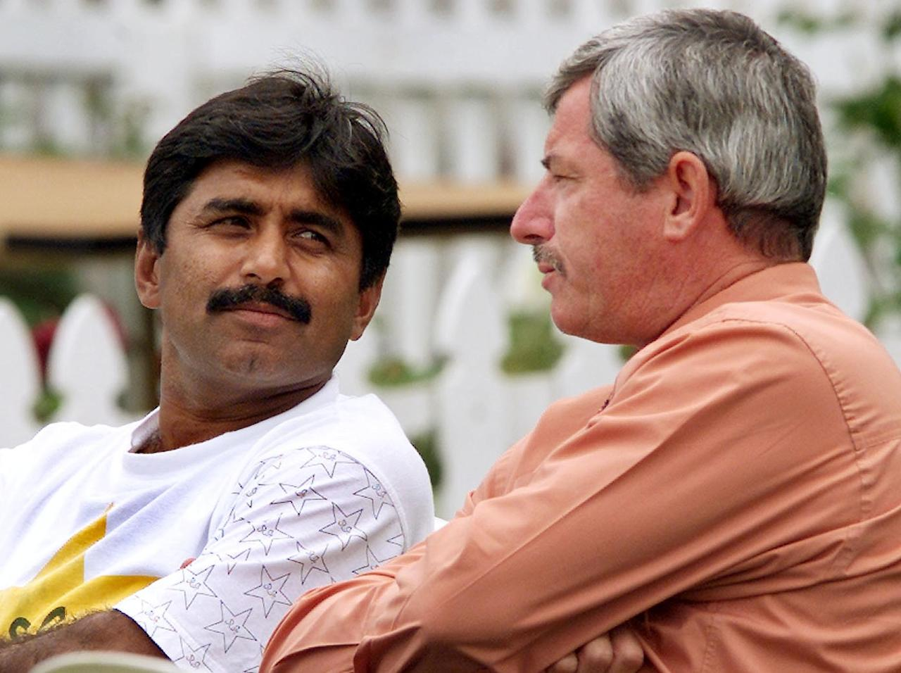 HAMILTON, NEW ZEALAND:  Two legends of the cricketing world, Pakistan coach Javed Miandad (L) and New Zealand selector Sir Richard Hadlee (R) chat on the first day of the third Test Match between the two countries being played in Hamilton 27 March 2001.  Pakistan was dismissed for only 104 in their first innings and at stumps New Zealand is in a commanding position at 160-0 with Richardson not out on 64 and Matthew Bell unbeaten on 89.  AFP PHOTO/WILLIAM WEST (Photo credit should read WILLIAM WEST/AFP/Getty Images)