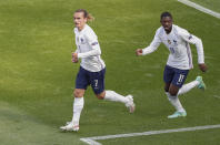 France's Antoine Griezmann, left, reacts after scoring his team's first goal during the Euro 2020 soccer championship group F match between Hungary and France at the Ferenc Puskas stadium in Budapest, Hungary, Saturday, June 19, 2021. (AP Photo/Laszlo Balogh,Pool)