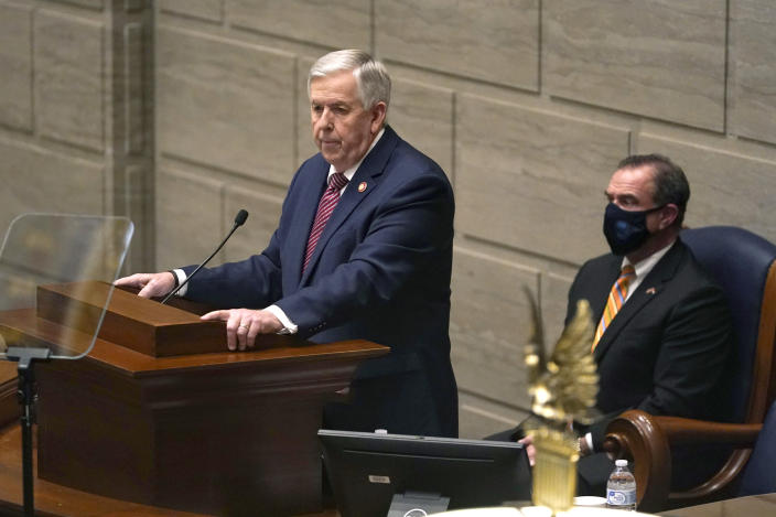 FILE - In this Jan. 27, 2021 file photo, Missouri Gov. Mike Parson delivers the State of the State address as Lt. Gov. Mike Kehoe, right, listens in Jefferson City, Mo. Parson dropped plans Thursday, May 13 to expand the state's Medicaid health care program to thousands of low-income adults after the Republican-led Legislature refused to provide funding for the voter-approved measure. The Republican governor said his administration had withdrawn a request to expand coverage that had been submitted to the federal Centers for Medicare and Medicaid Services in compliance with a constitutional amendment passed by voters last November. (AP Photo/Jeff Roberson, File)