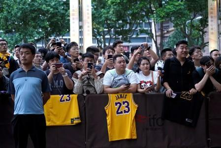 NBA fans wait outside a Ritz-Carlton hotel in Shanghai
