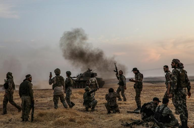 Turkish soldiers and Turkey-backed Syrian fighters on the outskirts of the Syrian city of Manbij near the Turkish border