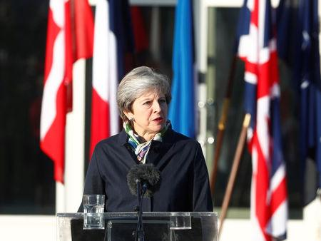 Britain's Prime Minister May makes a statement as she visits NATO Enhanced Forward Presence (EFP) battalion battle group in Tapa