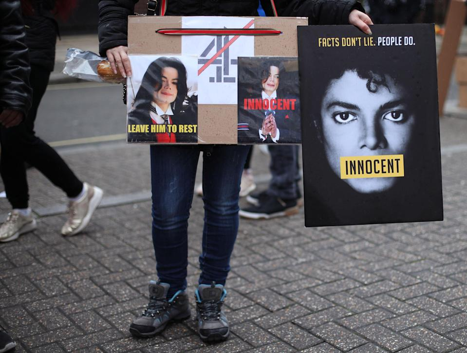Michael Jackson fans stage a protest outside the headquarters of Channel 4 on Horseferry Road, London, ahead of the airing of the documentary Leaving Neverland. (Photo by Yui Mok/PA Images via Getty Images)