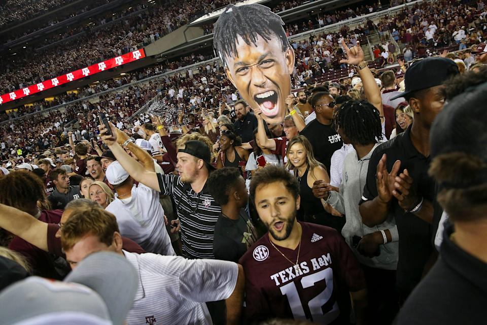 Texas A&M fans celebrate beating Alabama on Saturday.