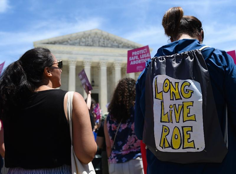 Abortion rights activists want the Supreme Court to protect the court's landmark 1973 decision in Roe v. Wade, which enshrined the right to abortion up to the point that the fetus is viable outside the womb, about 24 weeks (AFP Photo/Andrew CABALLERO-REYNOLDS)
