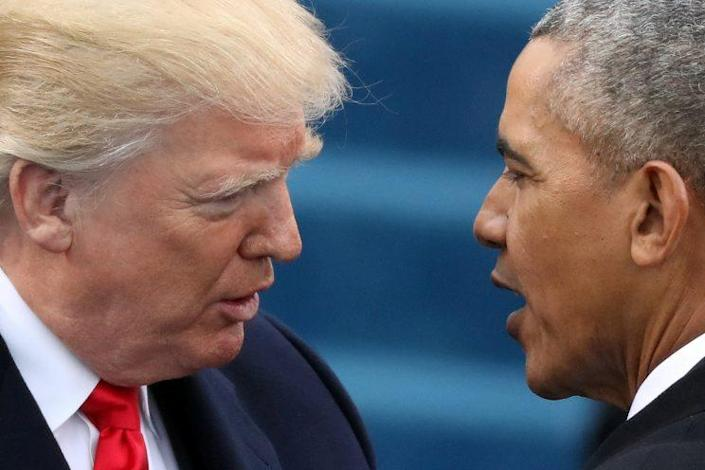 Obama greets Trump at Trump's presidential inauguration in Washington, D.C., in January. (Carlos Barria/Reuters)