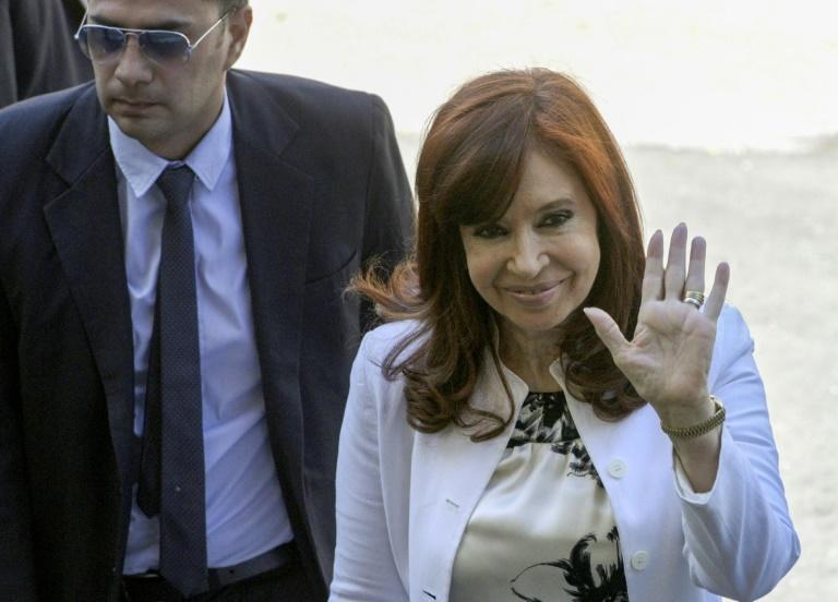 Former Argentine president Cristina Kirchner -- who assumes the vice presidency next  week -- waves as she arrives at a court in Buenos Aires