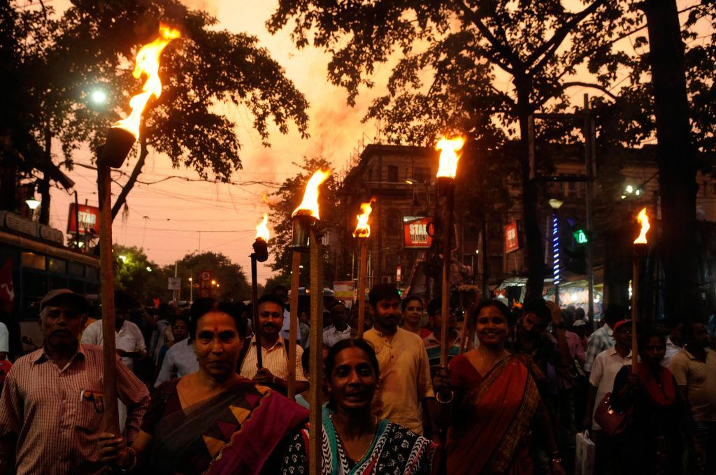 <p>Marchers in Kolkata, India hold torches during a rally to protest against violence in West Bengal Panchayat polls from Esplnade to Moulali crossing on May 4, 2018. (Photo from Samir Jana/Hindustan Times via Getty Images) </p>