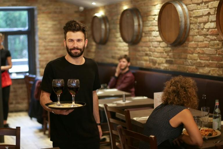 Young Italians increasingly find their homeland has few opportunities to offer them, so many, such as waiter Antonio Davide d'Elia, have sought their fortune abroad
