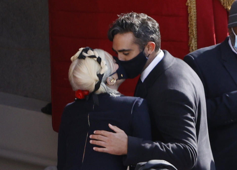 Lady Gaga kisses Michael Polansky during the inauguration of Joe Biden as the 46th President of the United States on the West Front of the U.S. Capitol in Washington, U.S., January 20, 2021. REUTERS/Brendan McDermid