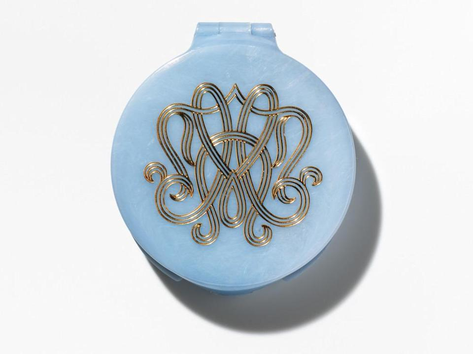 <p>This blue compact was the very first beauty counter gift with purchase. Estée Lauder apparently chose the pale turquoise color as the brand's signature because she felt it lent an air of luxury and was a versatile shade that would match any bathroom décor. <i>(Photo: Henry Leutwyler)</i></p>
