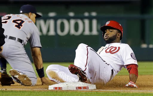 Washington Nationals' Denard Span, right, slides safely into third for a triple as Detroit Tigers third baseman Miguel Cabrera (24) waits for the ball during the third inning of a baseball game at Nationals Park, Wednesday, May 8, 2013, in Washington. (AP Photo/Alex Brandon)