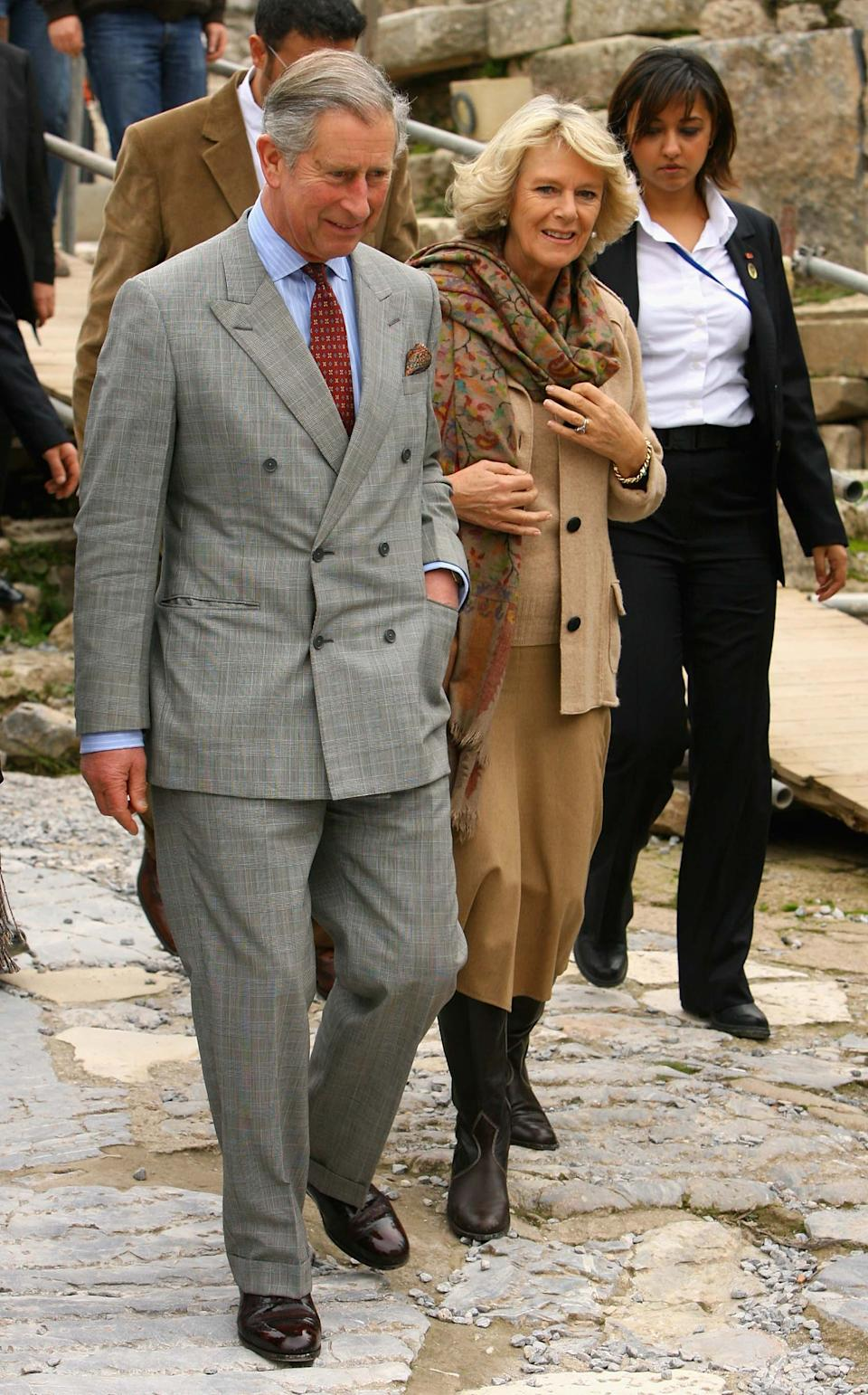 EPHESUS, TURKEY - NOVEMBER 27:  Camilla, Duchess of Cornwall and Prince Charles, Prince of Wales tour the library of Celsus built in AD 125 during a tour of the historical site of Ephesus on day two of a four day tour of Turkey on November 27, 2007 in Ephesus, Turkey. The Royal couple's tour will take in many historic and cultural sites.  (Photo by Chris Jackson/Getty Images)