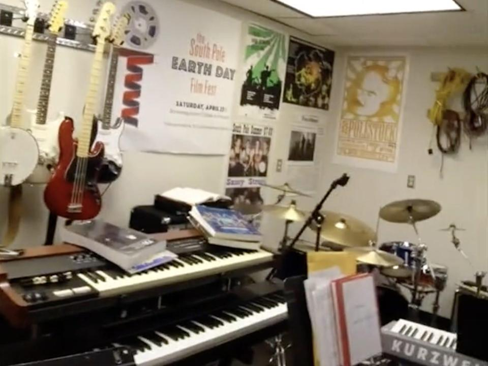 The music room at the Amundsen-Scott South Pole station is shown, filed with instruments like guitars, keyboard and drums.
