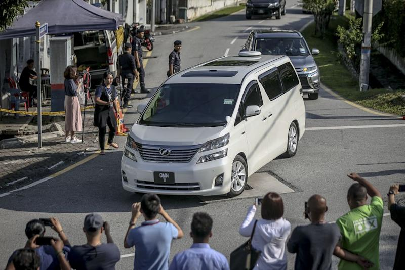 Datuk Seri Najib Razak's was seen his Langgak Duta residence at 9.20am accompanied by police escort, May 22, 2018. ― Picture by Hari Anggara