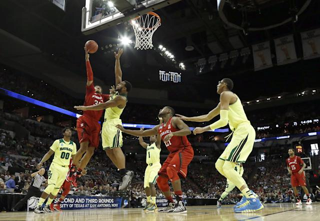 Nebraska's Shavon Shields (31) goes up for a shot as Baylor's Rico Gathers (2) defends during the first half of a second-round game in the NCAA college basketball tournament Friday, March 21, 2014, in San Antonio. (AP Photo/David J. Phillip)