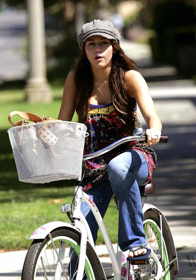 """Miley Cyrus can't wait to ditch her bike for a four-wheeler. At the top of her birthday gift list is a new car. Miley will be celebrating her sweet 16 in October at Disneyland. Fans can fork over $250 if they want to join in the fun. Gerallt Radcliffe/<a href=""""http://www.pacificcoastnews.com/"""" target=""""new"""">PacificCoastNews.com</a> - August 23, 2008"""