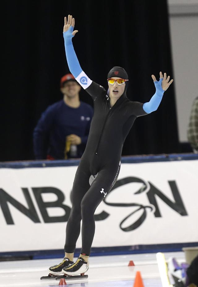 Emery Lehman celebrates after competing in the men's 5,000-meter during the U.S. Olympic speedskating trials on Friday, Dec. 27, 2013, in Kearns, Utah. Lehman came in second place. (AP Photo/Rick Bowmer)