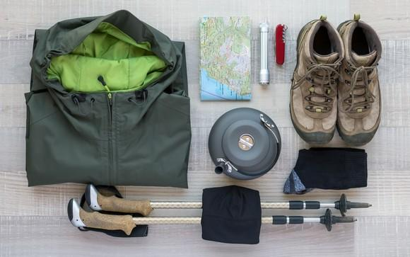 Hiking apparel and equipment arranged neatly on a table
