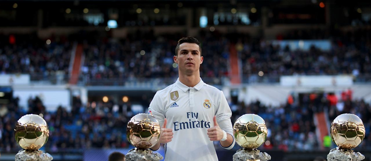 Football Soccer - Real Madrid v Granada - Spanish La Liga Santander - Santiago Bernabeu stadium, Madrid, Spain - 7/1/17 Real Madrid's Cristiano Ronaldo poses with his 4 Ballon d'Or (Golden Balls) before their Spanish first division soccer match against Granada.REUTERS/Stringer