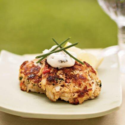 """<p>Garnish these miniature crab cakes with chives for a savory <a href=""""https://www.myrecipes.com/appetizer-recipes/"""" rel=""""nofollow noopener"""" target=""""_blank"""" data-ylk=""""slk:appetizer"""" class=""""link rapid-noclick-resp"""">appetizer</a>. Serve with lemon wedges. </p><p><a href=""""https://www.myrecipes.com/recipe/mini-crab-cakes-with-herbed-aioli"""" rel=""""nofollow noopener"""" target=""""_blank"""" data-ylk=""""slk:Mini Crab Cakes with Herbed Aioli Recipe"""" class=""""link rapid-noclick-resp"""">Mini Crab Cakes with Herbed Aioli Recipe</a></p>"""