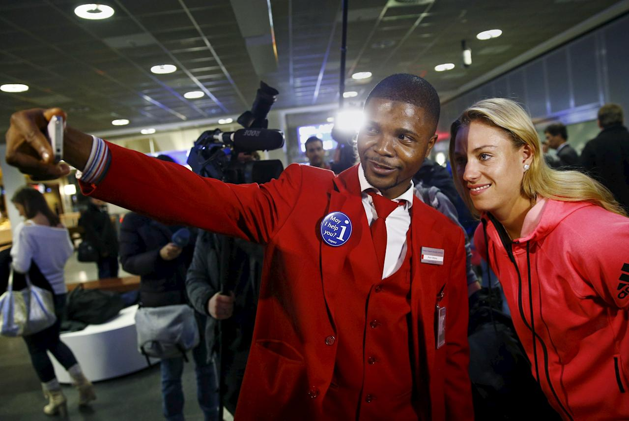 Australian Open winner Angelique Kerber of Germany poses for a picture with an airport employee after her arrival at the airport in Frankfurt, Germany