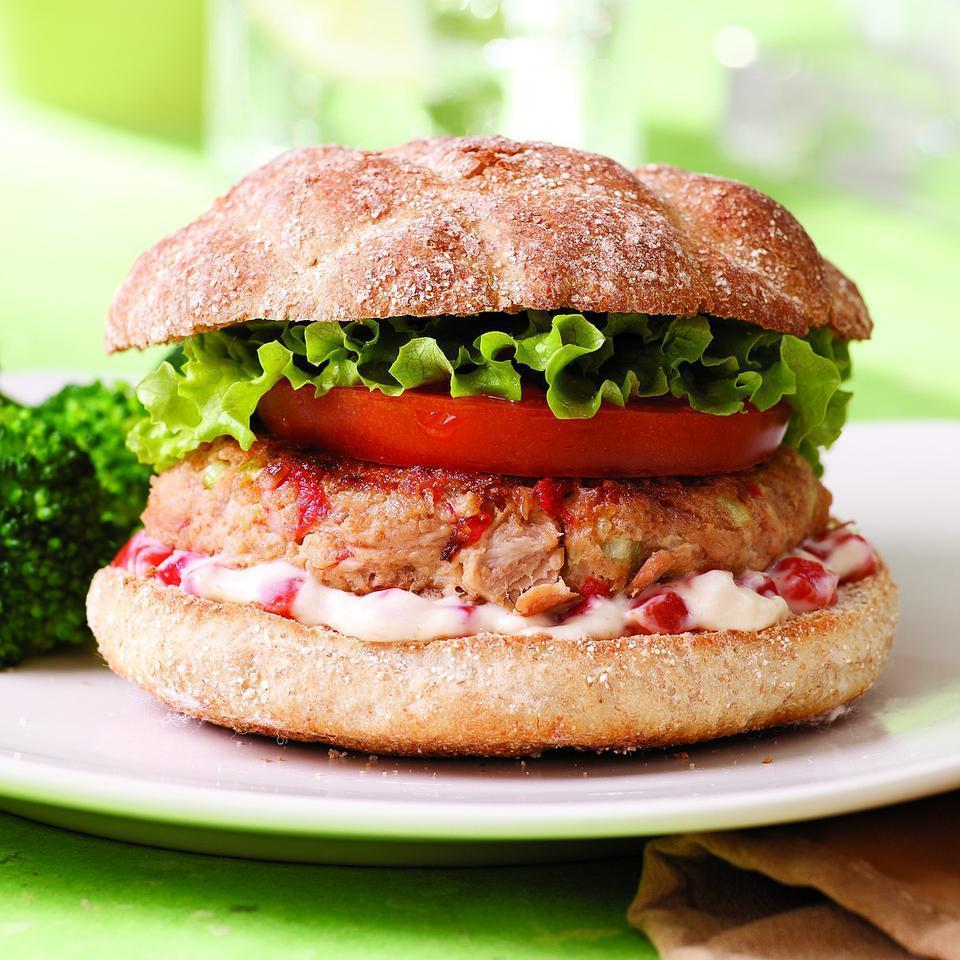 <p>Turn a couple cans of tuna into a zesty tuna burger with this quick recipe. If you can't find good whole-wheat hamburger buns, whole-wheat English muffins are a great substitute. The burger mixture might seem a little soft going into the pan, but once the first side is cooked, you'll be able to flip them easily. Serve with steamed broccoli or sweet potato fries.</p>