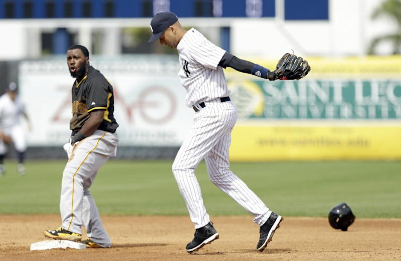 New York Yankees shortstop Derek Jeter reacts after tagging out Pittsburgh Pirates' Josh Harrison, left, during a stolen base attempt in the fifth inning of an exhibition baseball game Thursday, Feb. 27, 2014, in Tampa, Fla. (AP Photo/Charlie Neibergall)