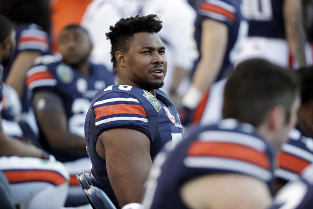 FILE - In this Dec. 28, 2018, file photo, Auburn offensive lineman Prince Tega Wanogho (76) watches from the sideline in the second half of the Music City Bowl NCAA college football game against Purdue, in Nashville, Tenn. Prince Tega Wanogho came to Alabama from Nigeria wanting to be the next LeBron James. He became Auburns left tackle instead. (AP Photo/Mark Humphrey, File)