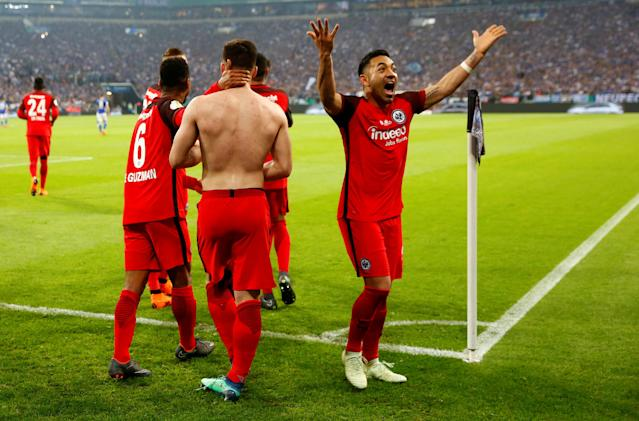 Soccer Football - DFB Cup - Schalke 04 vs Eintracht Frankfurt - Veltins-Arena, Gelsenkirchen, Germany - April 18, 2018 Eintracht Frankfurt's Marco Fabian celebrates after Luka Jovic scored their first goal REUTERS/Wolfgang Rattay DFB RULES PROHIBIT USE IN MMS SERVICES VIA HANDHELD DEVICES UNTIL TWO HOURS AFTER A MATCH AND ANY USAGE ON INTERNET OR ONLINE MEDIA SIMULATING VIDEO FOOTAGE DURING THE MATCH.