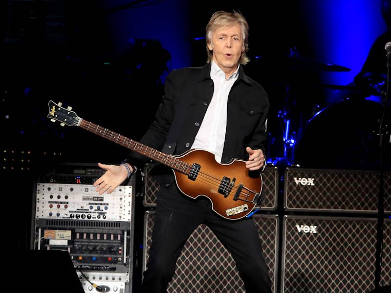 Paul McCartney: 'Kanye West couldn't stop looking at photos of Kim Kardashian in the studio'