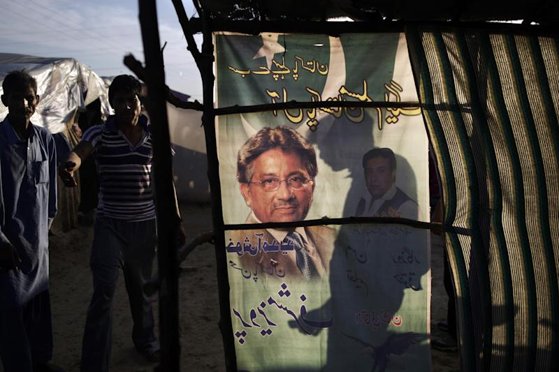 An election banner showing Pakistan's former president and military ruler Pervez Musharraf, is used as a curtain on a makeshift home in a Christian slum on the outskirts of Islamabad, Pakistan, Wednesday, April 17, 2013. Musharraf appeared in court to seek bail in Benazir Bhutto's assassination case. Pakistan's Supreme Court ordered Musharraf to respond to allegations that he committed treason while in power, and barred him from leaving the country only weeks after he returned. (AP Photo/Muhammed Muheisen)