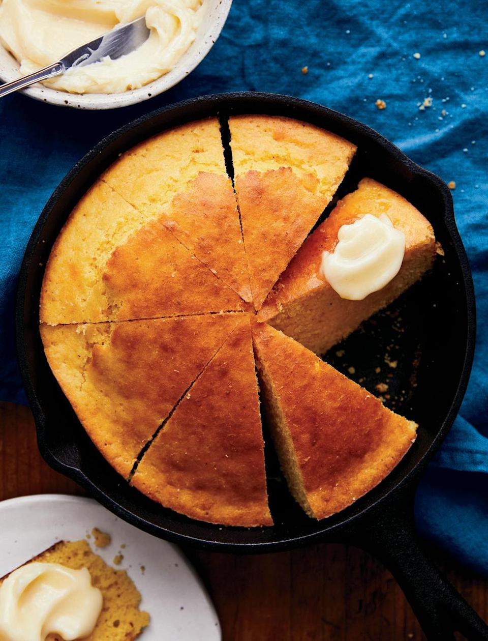 """<p>No good country Thanksgiving is complete without a slice of skillet cornbread.</p><p><strong><a href=""""https://www.countryliving.com/food-drinks/a34276804/skillet-cornbread-with-honey-butter/"""" rel=""""nofollow noopener"""" target=""""_blank"""" data-ylk=""""slk:Get the recipe"""" class=""""link rapid-noclick-resp"""">Get the recipe</a>.</strong> </p>"""