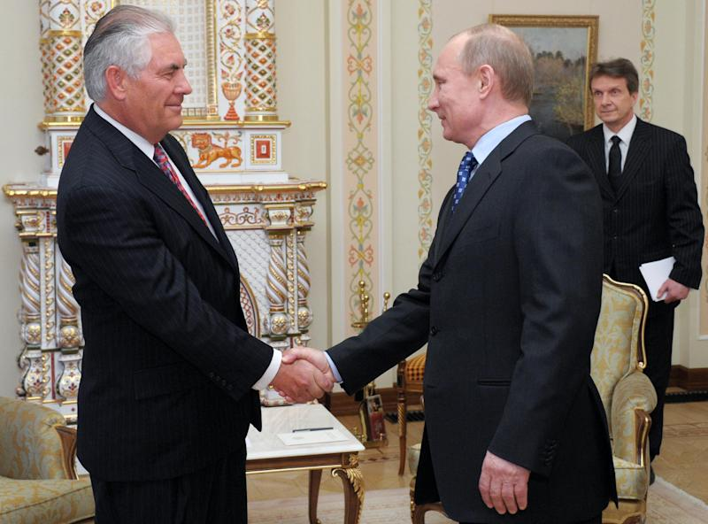FILE - In this April 16, 2012, file photo, Russian Prime Minister Vladimir Putin, right, shakes hands with Rex W. Tillerson, chairman and chief executive officer of Exxon Mobil Corporation at their meeting in the Novo-Ogaryovo residence outside Moscow. ExxonMobil and Rosneft could invest over $500 billion in a joint venture to explore for and produce oil in the Arctic and the Black Sea, the companies announced on Wednesday, April 18.  ExxonMobil has teamed up with Rosneft to develop oil and natural gas fields in Russia and North America. (AP Photo/RIA-Novosti, Alexei Nikolsky, Government Press Service, File)