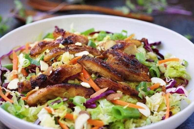 """<strong>Get the <a href=""""https://iheartumami.com/paleo-asian-chicken-cabbage-salad/"""" target=""""_blank"""" rel=""""noopener noreferrer"""">Paleo Asian Chicken Salad</a> recipe from I Heart Umami.</strong>"""