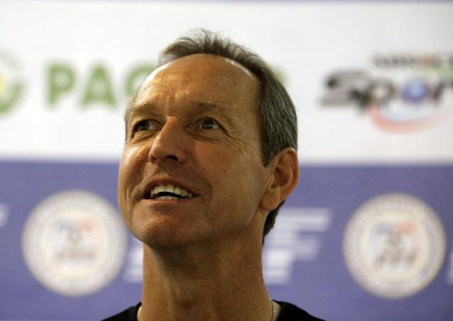 "Former U.S. captain Thomas Dooley poses for photographers following his appointment as the new head coach of the Philippine national football team known as ""Azkals"" Friday, Feb. 7, 2014 at suburban Pasig city, east of Manila, Philippines. Dooley, who replaced German coach Michael Weiss, will start immediately preparing the team for the Challenge Cup in May in the Maldives. It will be Dooley's first time to coach a national team and he said he is ""very honored, humbled and very excited to take this task."" (AP Photo/Bullit Marquez)"