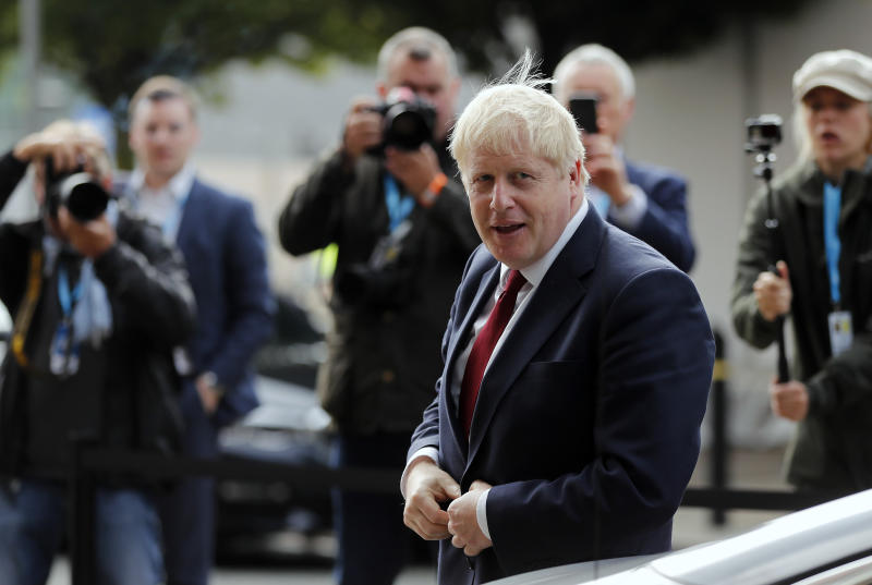 Britain's Prime Minister Boris Johnson arrives at the Conservative Party Conference in Manchester, England, Monday, Sept. 30, 2019. Johnson's office denied a journalist's claim that Johnson grabbed her thigh at a private lunch two decades ago. Sunday Times columnist Charlotte Edwardes says the incident took place when she worked at The Spectator, a conservative newsmagazine, while Johnson was its editor. (AP Photo/Frank Augstein)