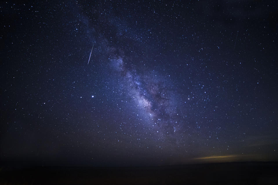 A Lyrid meteor crosses the Milky Way galaxy in this photo taken by Tina Pappas Lee on Fripp Island, South Carolina. The photo was taken at approximately 4:45 a.m. local time on April 22, 2020.