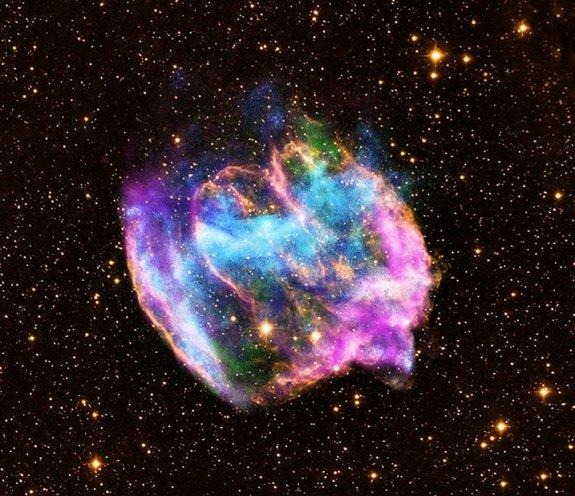 The highly distorted supernova remnant W49B in this image may contain the youngest black hole in the Milky Way galaxy. The image combines X-rays from NASA's Chandra X-ray Observatory in blue and green, radio data from the NSF's Very Large Array