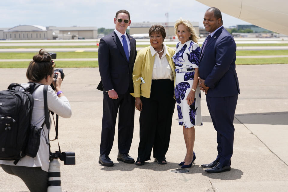 First lady Jill Biden poses for a photo with Dallas Mayor Eric Johnson, right, Rep. Eddie Bernice Johnson, D-Texas, second from left, and Dallas County Judge Clay Jenkins as she arrives at Love Field Airport in Dallas, Tuesday, June 29, 2021. (AP Photo/Carolyn Kaster, Pool)