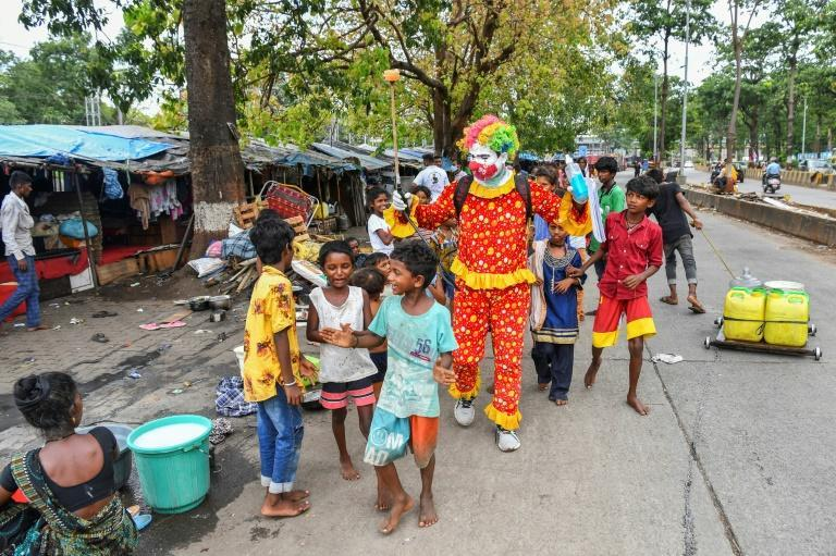 Ashok Kurmi spends around a third of his salary on buying costumes, make-up supplies and sanitation equipment for his voluntary work
