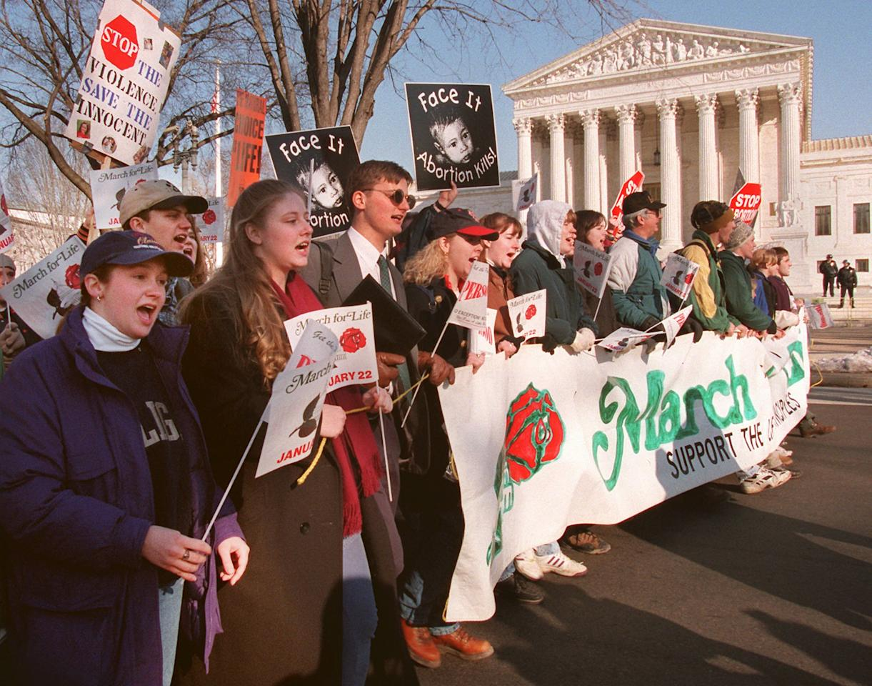 Abortion opponents march in front of the Supreme Court in Washington Monday Jan. 22, 1996 during their 23rd annual march against the court's decision to legalize abortion. The group used this year's protest to urge President Clinton to sign legislation limiting a woman's right to abortion. (AP Photo/Doug Mills)