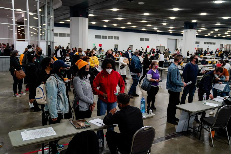 People wait to check in at the vote-counting center.
