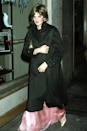 <p>This snap of Diana was taken as she left the Ritz Hotel after attending Princess Margaret's 50th birthday party, when rumours first started circulating of her romance with Charles. You can see a blush pink ballgown with pinstripe details poking out from underneath her black overcoat and, wow, do we wish we could see the whole thing!</p>